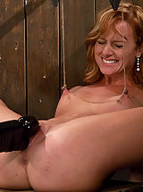 Kink Pussy: Sexy tan natural red head, bound spread with hard metal.