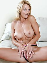 Clitoris, Bare skinned Brenda James spreads her pussy lips before drilling her juice box with a stiff dildo
