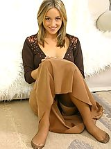 Melanie in a revealing brown top and long brown dress.