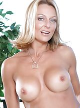 Tan Line Babes: Long haired mature Anilos loves to expose her well mouth watering assets on the terrace