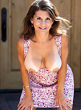 Elegant mature woman flaunts her curvy bod outdoors in a sundress