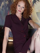 Small bosomed curly redhead Ande exposes her older slit.
