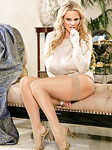 Kelly wears a see thru top and rubs on her clit on a chaise lounge.