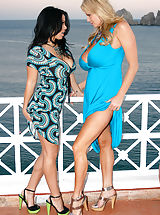 Playmates Pics: Kelly and Sienna enjoy the ocean breeze as they suck on pussy in Cabo.