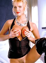 Suze Randall Pics: A sexy blonde in lacy lingerie, Ashleigh makes magic happen in the boudoir.