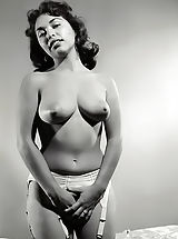 Pinup burlesque classic girls of the 40's-50's pose to show their nice legs perfect knockers