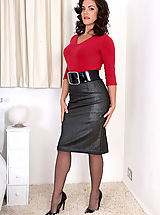 Secretary Babes: Sweater girl Rebekah teases and strips down to corselette and nylons