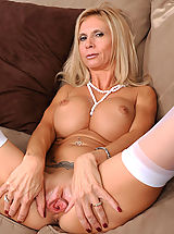 Clit, Beautiful blonde Anilos lady shows off her big breasts and juicy milf pussy